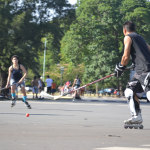 People playing streethockey in the parks