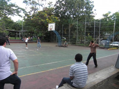 Guys playing an alternative baseball game