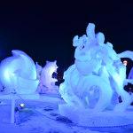 Snow sculptures festival at night