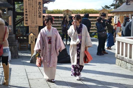 Japanese girls doing the love-walk-of-faith between the love stones