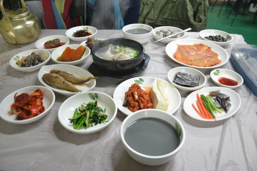 Makkoli or makgeolli meal with tons of side dishes