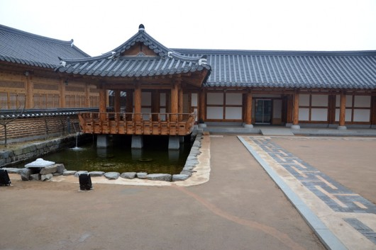 Korean Hanok village houses with pond