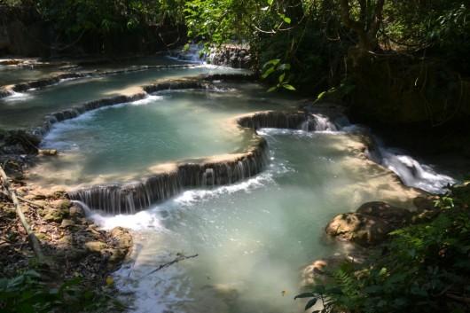Multi-tier waterfalls at Tat Kuang Si