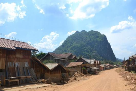 Dusty roads in Nong Khiaw with a limestone mountain backdrop