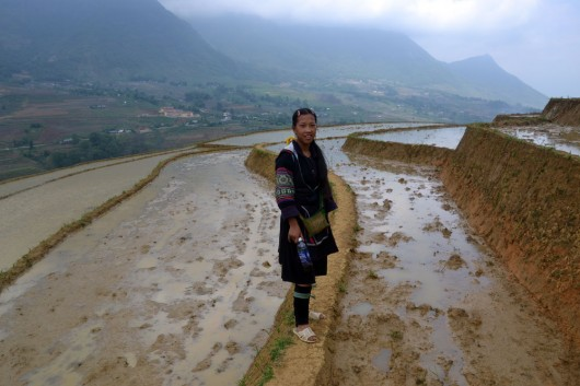 Cho-Cho's daughter leading the way dressed in her Hmong clothes