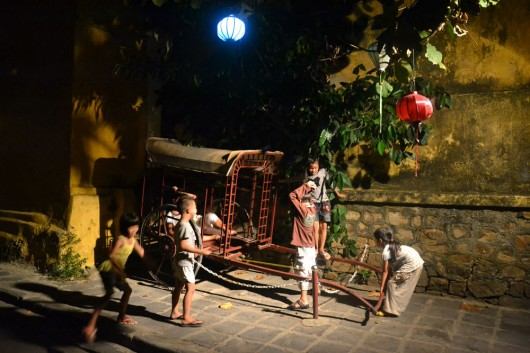 Kids playing around at night in Hoi An