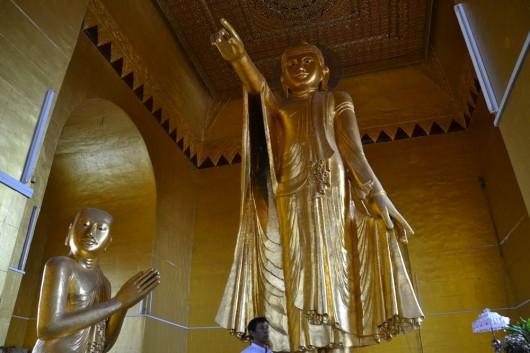 Enormous standing Buddha pointing down at Mandalay