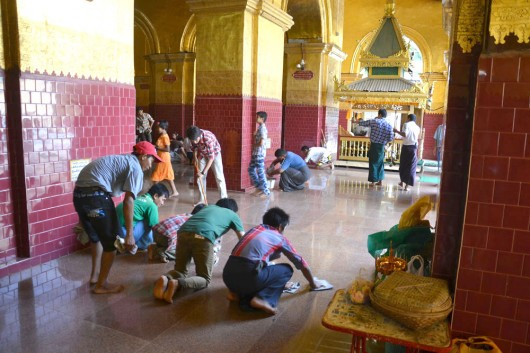 Worshippers help clean the temple floors, its a team effort