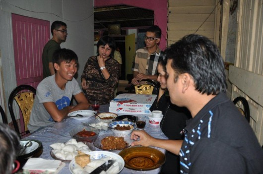 Me and Izads family at the grown-ups table with the home cooked dishes