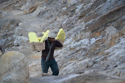 Workers carrying out sulphur blocks