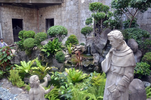 Small pond in the inner garden of the Basilica of Santo Niño