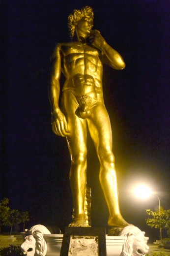 Enormous golden naked David statue in Davao