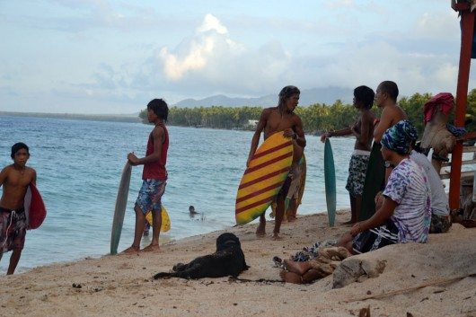 Local skimboarders in Mati