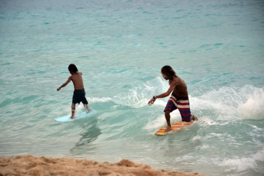 Local skimboarders catching waves