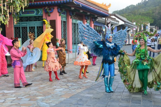 Performers putting up a show for the tourists