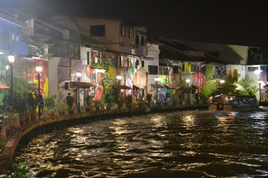 Colorful murals on the bank of the river