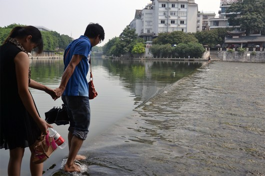 Couple getting ready to cross the river