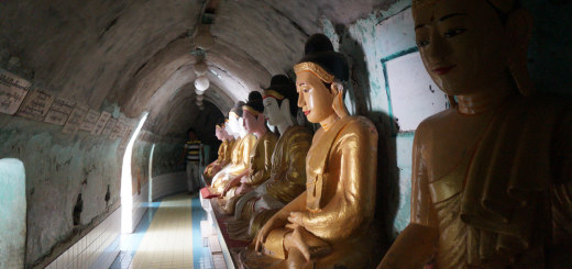 64 seated Buddha statues in a tunnel around Shwegugale Paya