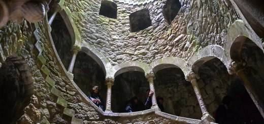 Asian backpacker - Sintra - Quinta da Regaleira well of initiation