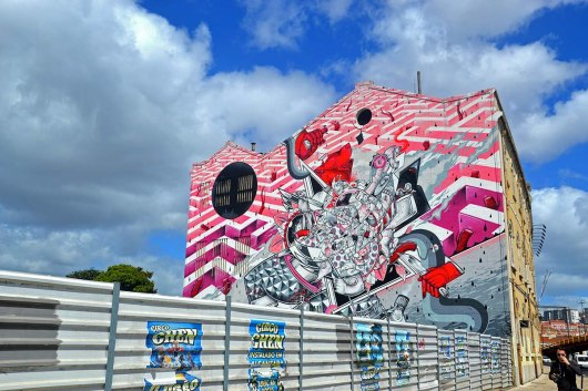 Asian backpacker - Lisbon LX factory street art