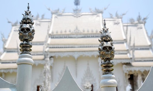 Asian backpacker - Chiang Rai white temple detail