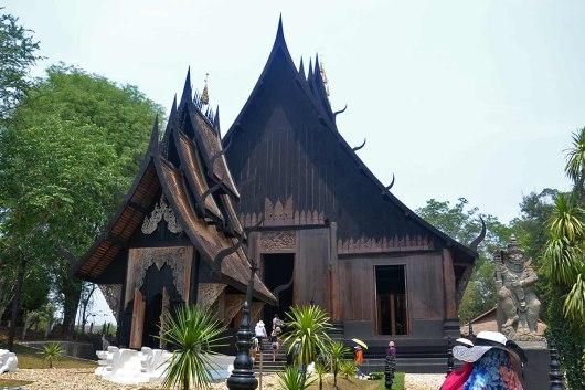 Asian backpacker - Chiang Rai black house/temple